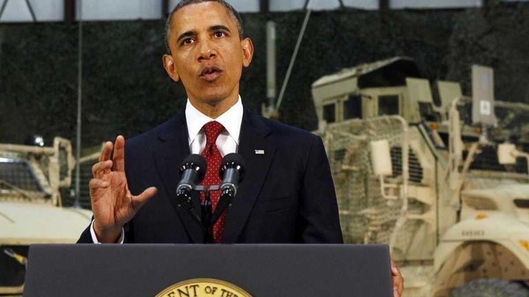 President Barack Obama talks to soldiers at Bagram