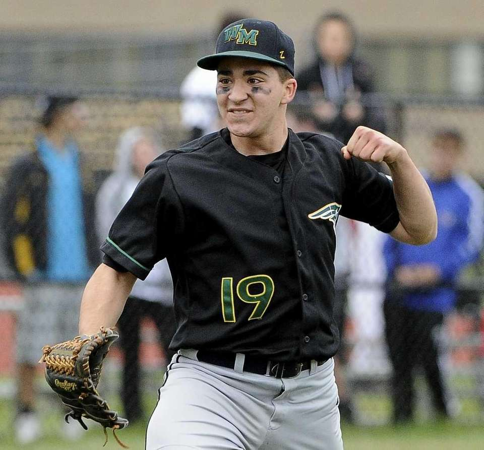 Ward Melville pitcher Gregory Coman reacts after getting