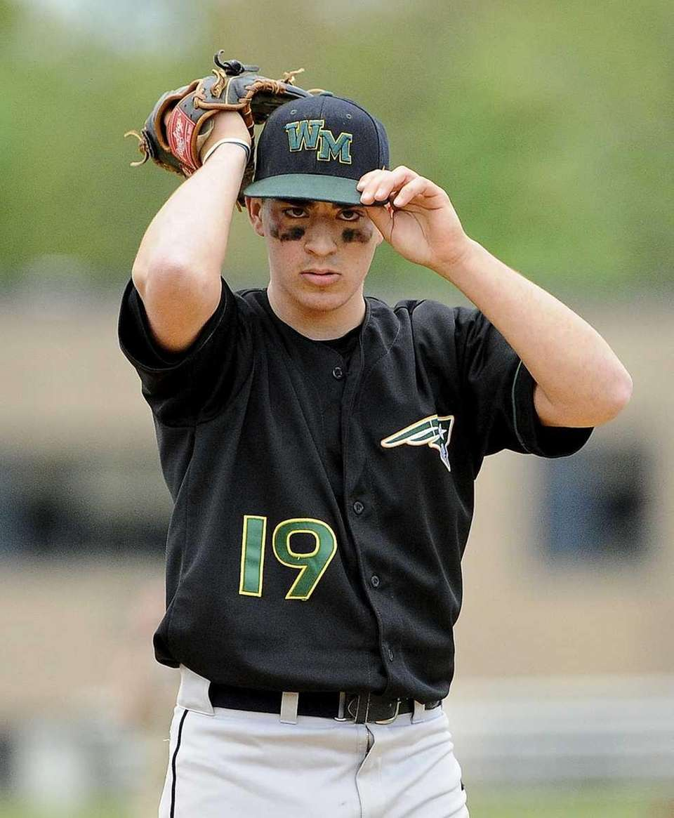 Ward Melville pitcher Gregory Coman readies himself in