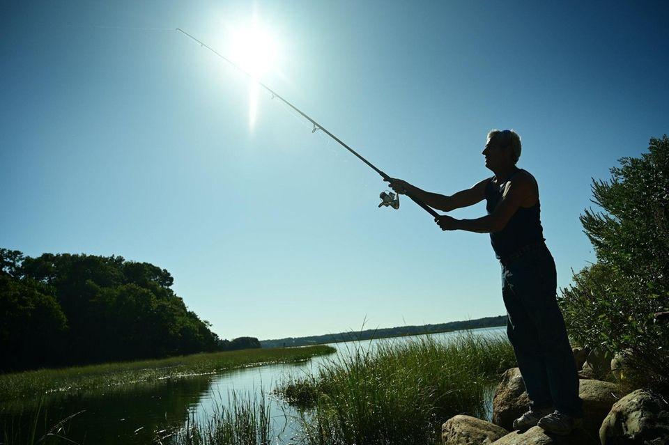 Dave Stuart of Centereach tries his fishing skills