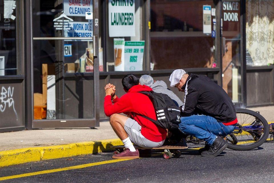 Friends gather at the scene where Khaseen Morris