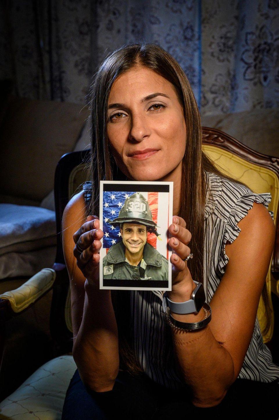 Miriam Espinal, 38, of Glen Cove, holding a