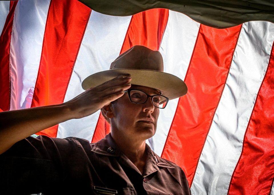 NYS Trooper Kristen Erario saluting the colors being