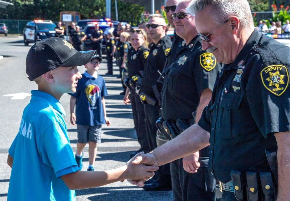 Douglas Grimmett, 12, acting Sheriff of the day
