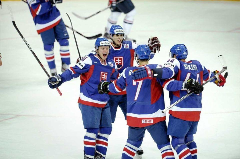 Slovakia's Milan Bartovic, left, Mario Bliznak, Ivan Baranka