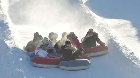 A group enjoys tubing at Jack Frost Ski