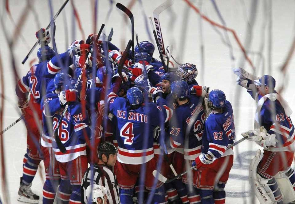 The New York Rangers celebrate Marc Staal's overtime
