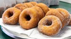 Apple cider donuts — from left, cinnamon-sugar, plain