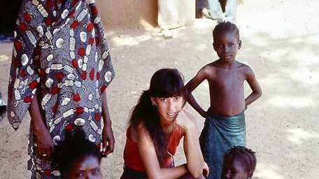 Beth Whitehouse, center, with friend Fati and her