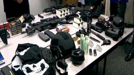 Authorities display some of the cache of illegal