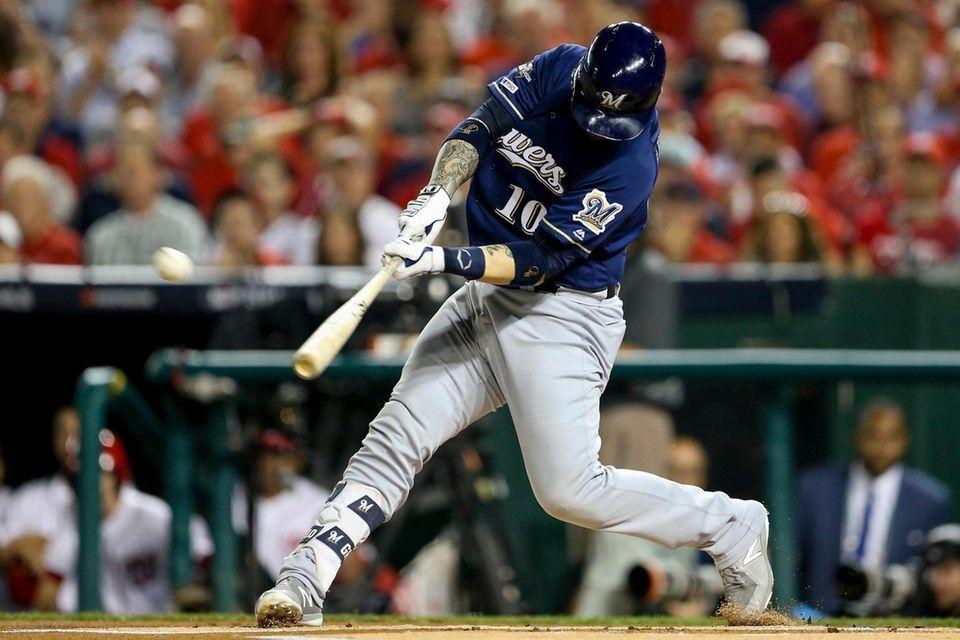 Milwaukee Brewers' Yasmani Grandal hits a two-run home