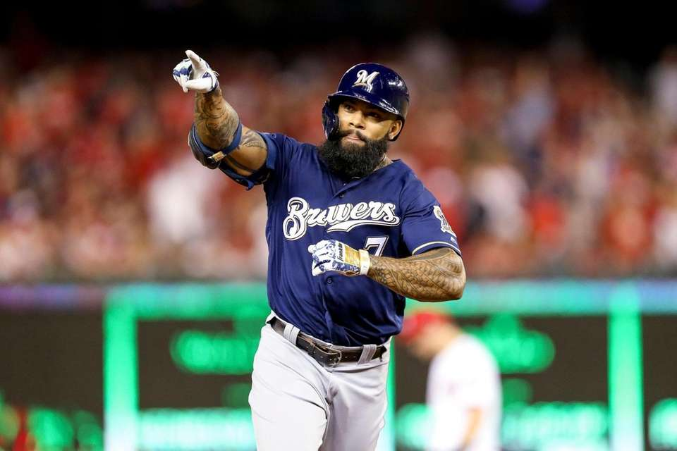 Milwaukee Brewers' Eric Thames gestures after hitting a