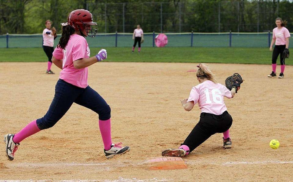 Smithtown East shortstop Maggie Engellener's throw to first