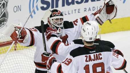 New Jersey Devils' Martin Brodeur, Travis Zajac and