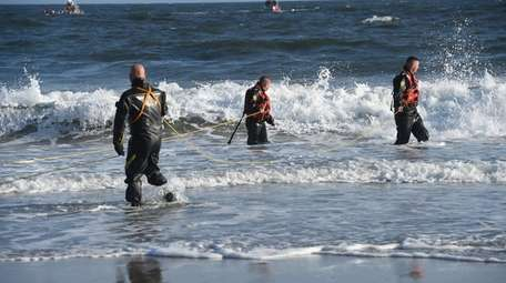 A search team at Rockaway Beach Tuesday afternoon