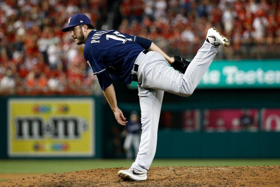 Milwaukee Brewers relief pitcher Drew Pomeranz follows through