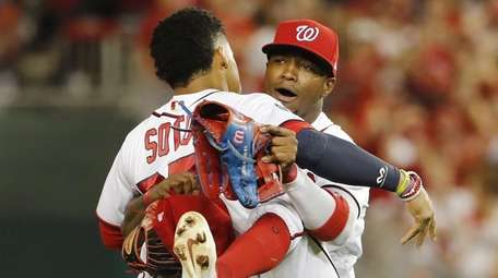 The Nationals' Juan Soto, celebrates with teammate Victor