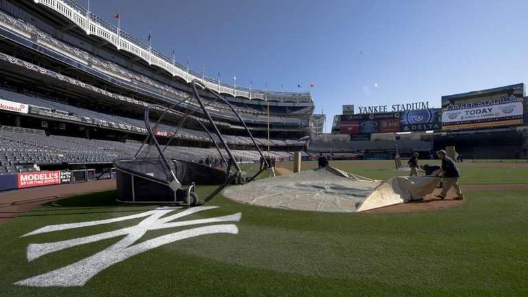 The field crew setting up for batting practice