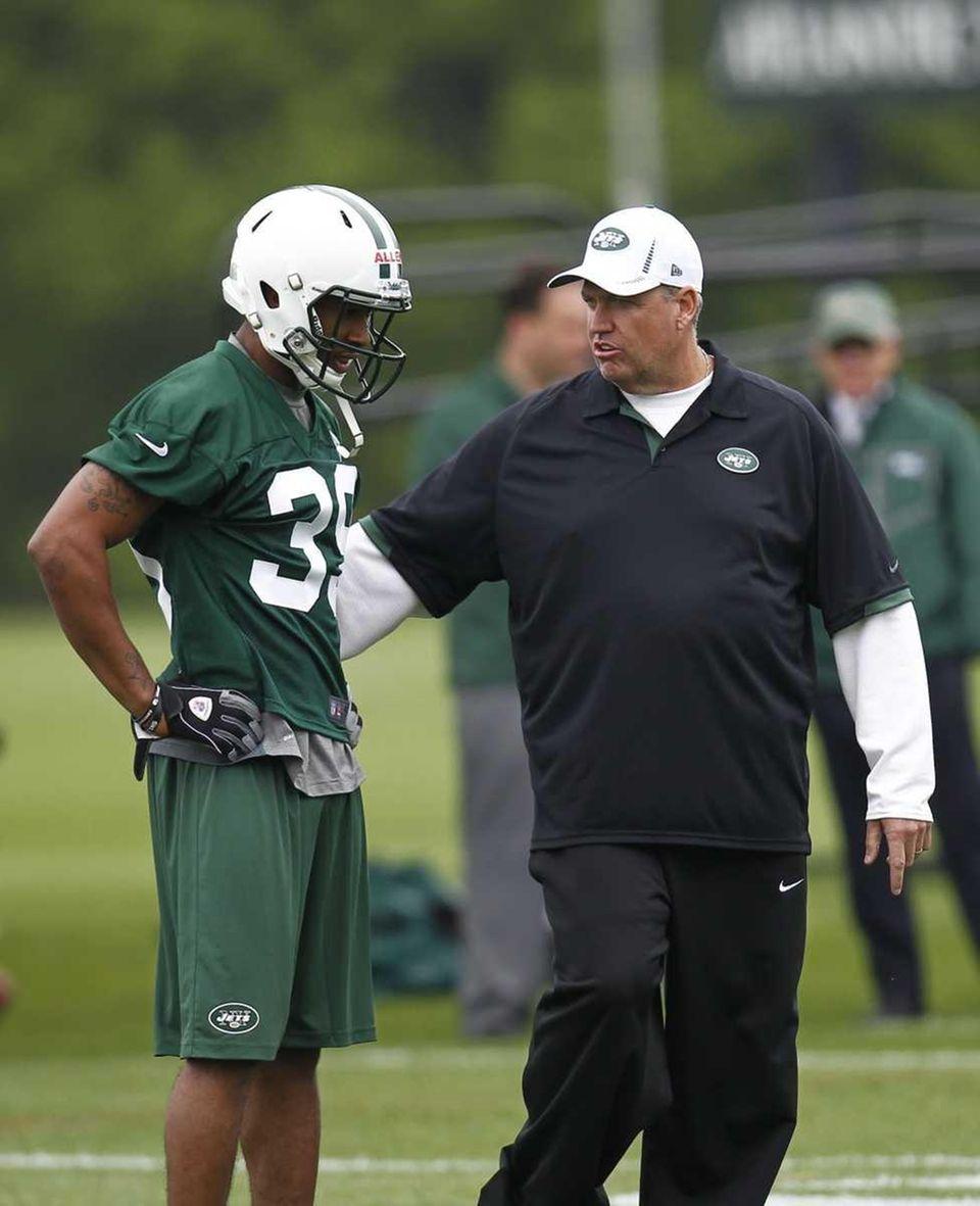 Rex Ryan talks with Antonio Allen during