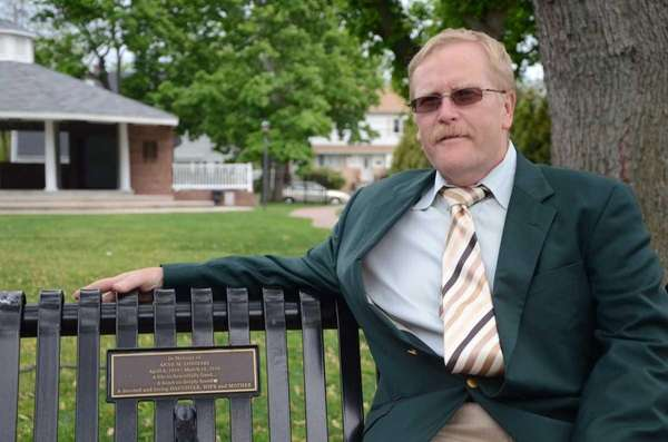 Farmingdale Mayor Ralph Ekstrand, 57, sits on a