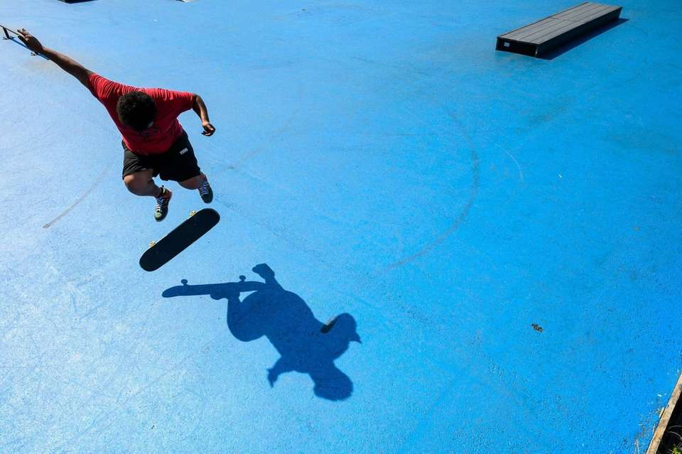 Chris Acosta of Queens practices his skating skills