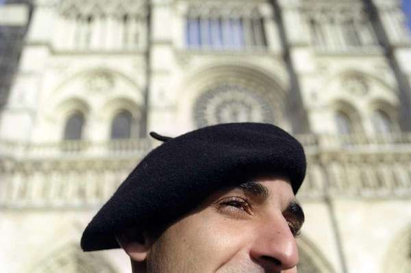 At Notre-Dame Cathedral in Paris, France (2003).