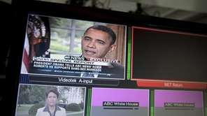 President Barack Obama is seen on television monitors