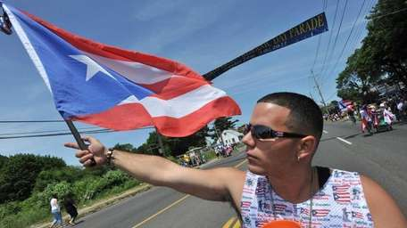 Joseph Alonso of Bay Shore waves his Puerto