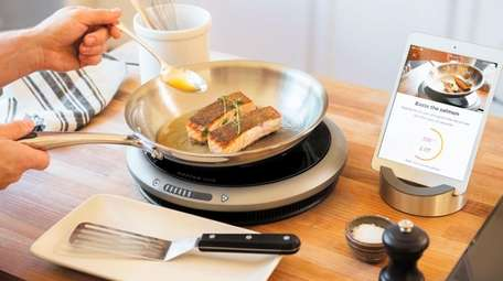 The Hestan Cue Smart Cooking System features a