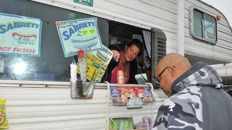 Catherina Scalia serves a customer. (May 9, 2012)