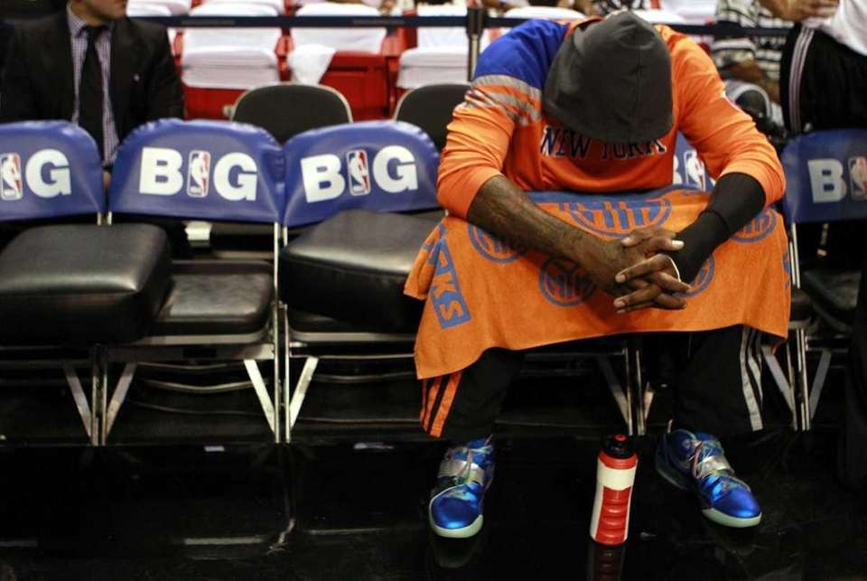 Amar'e Stoudemire sits on the bench against the