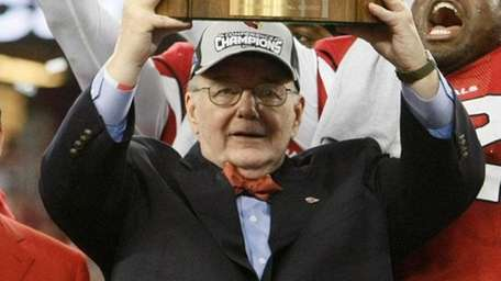 Arizona Cardinals owner Bill Bidwell holds up the