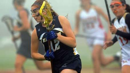 West Babylon's Samantha Apuzzo (12) drives to the