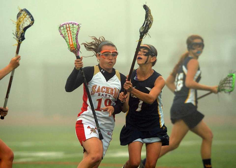 Sachem East's Mary Vecchio (19) drives while West
