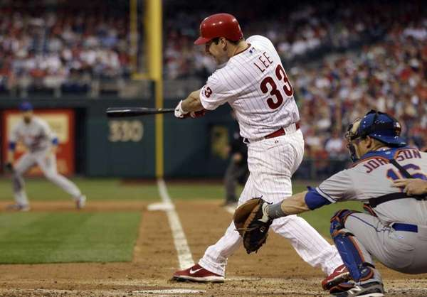 Philadelphia Phillies' Cliff Lee hits an RBI single