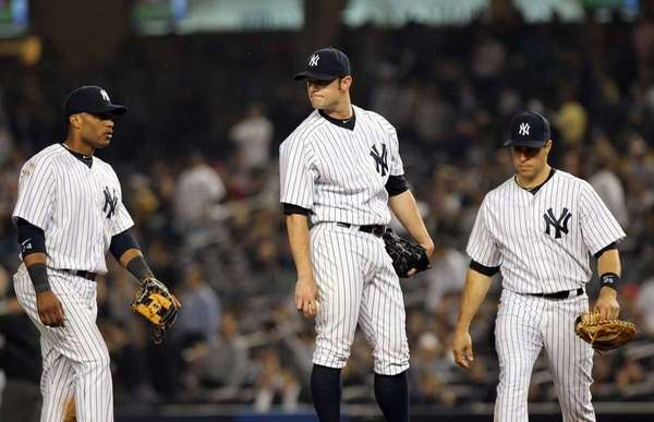 David Robertson reacts after giving up a three-run