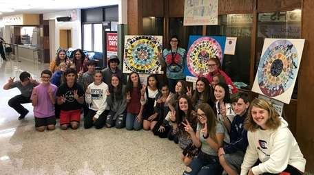 Sayville High School students with colorful mandalas they