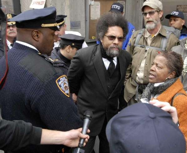 Political activist Dr. Cornel West is taken into