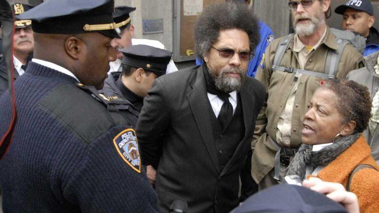 Political activist Dr. Cornel West is taken into