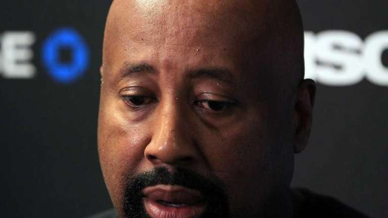 Knicks interim head coach Mike Woodson talks to