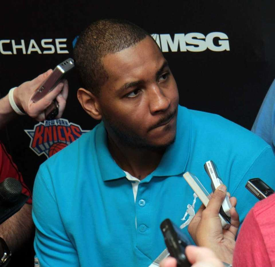 Carmelo Anthony talks to the media as the