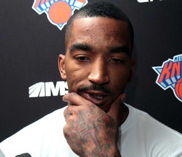 Knicks guard J.R. Smith talks to the media