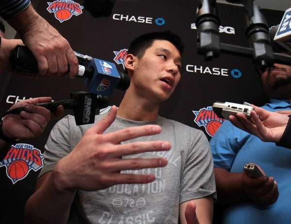 Knicks guard Jeremy Lin talks to the media
