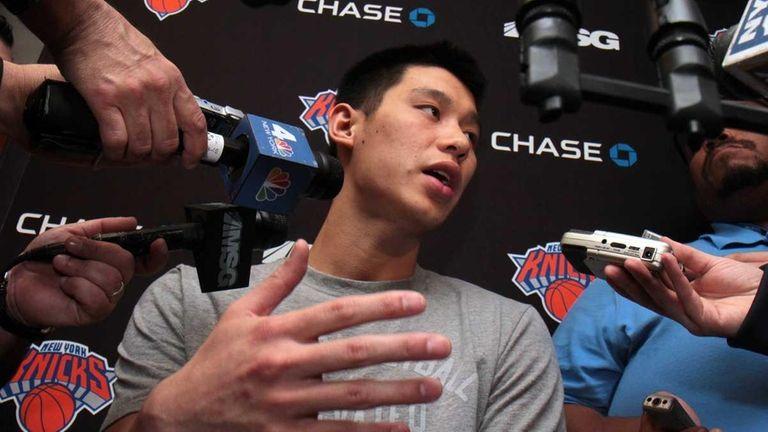 Knicks guard Jeremy Lin talks to the media