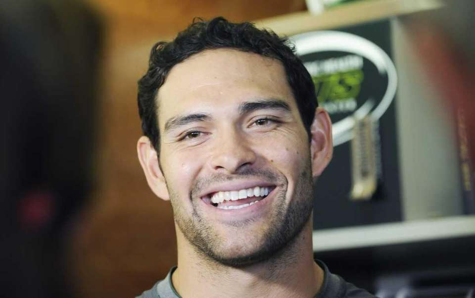 Jets quarterback Mark Sanchez talks to the media