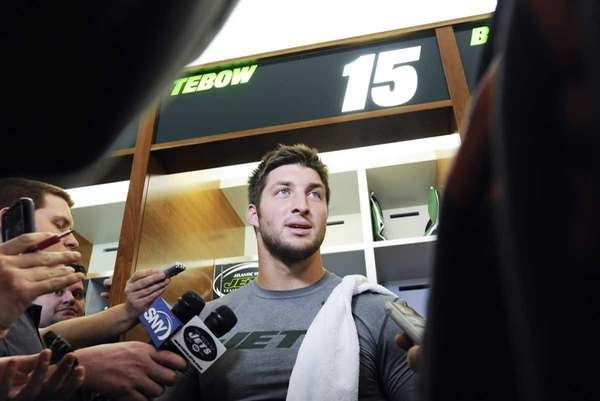 Jets quarterback Tim Tebow talks to the media