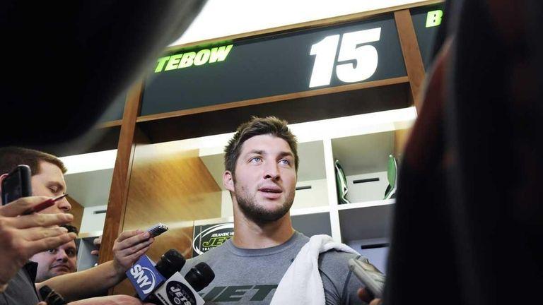 Jets quarterback Tim Tebow talks to the media