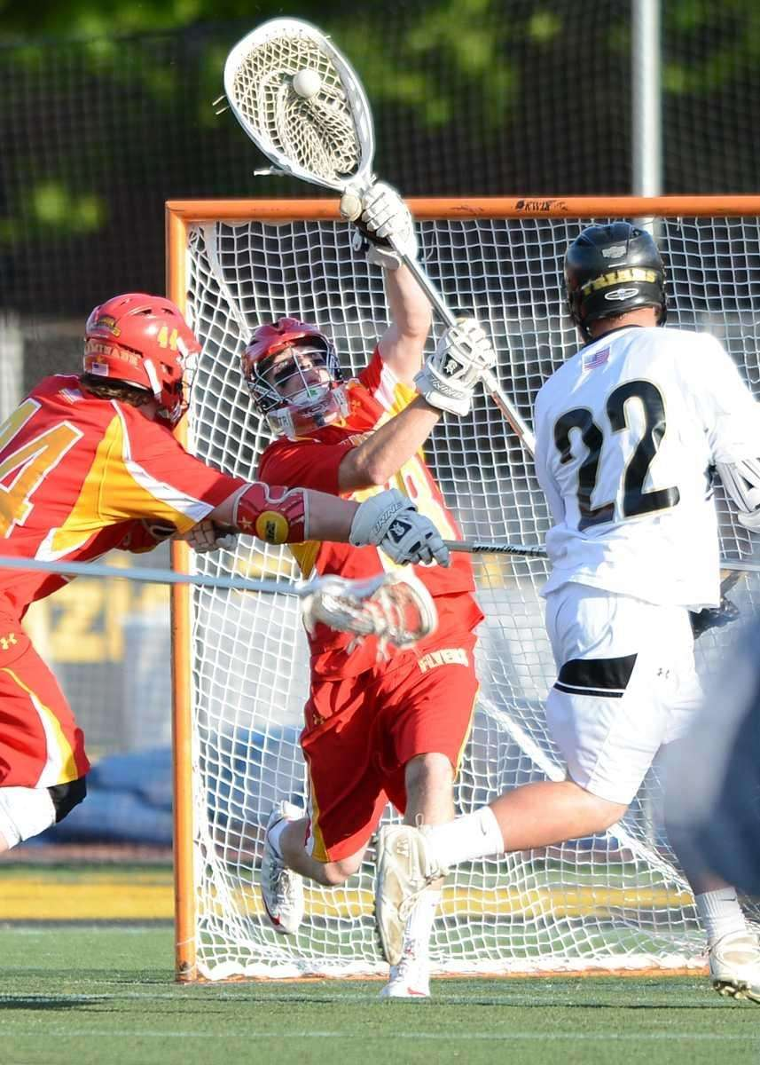 Chaminade goalie Daniel Fower makes the save on