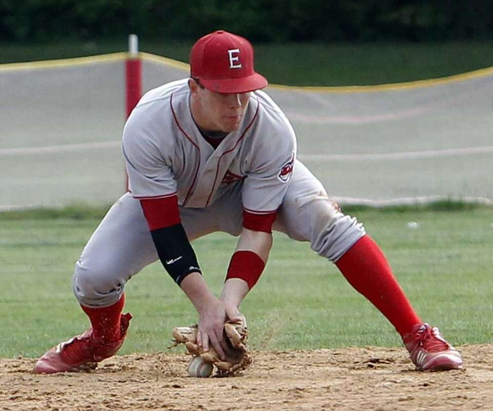 East Islip second baseman James Reed (6) can't