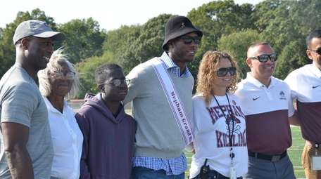Former NFL player Donny Brady, center, was honored